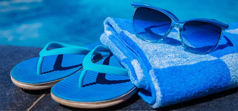 summer flip flops towel sunglasses