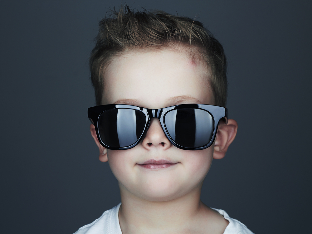 little boy with cool haircut and sunglasses