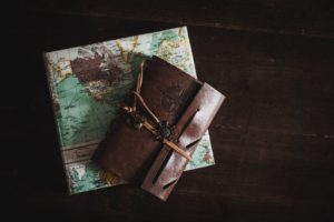 map and a travel notebook