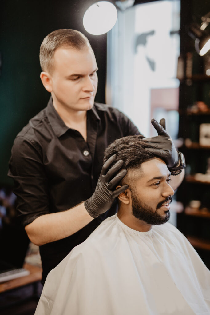 Barber evaluating clients hair