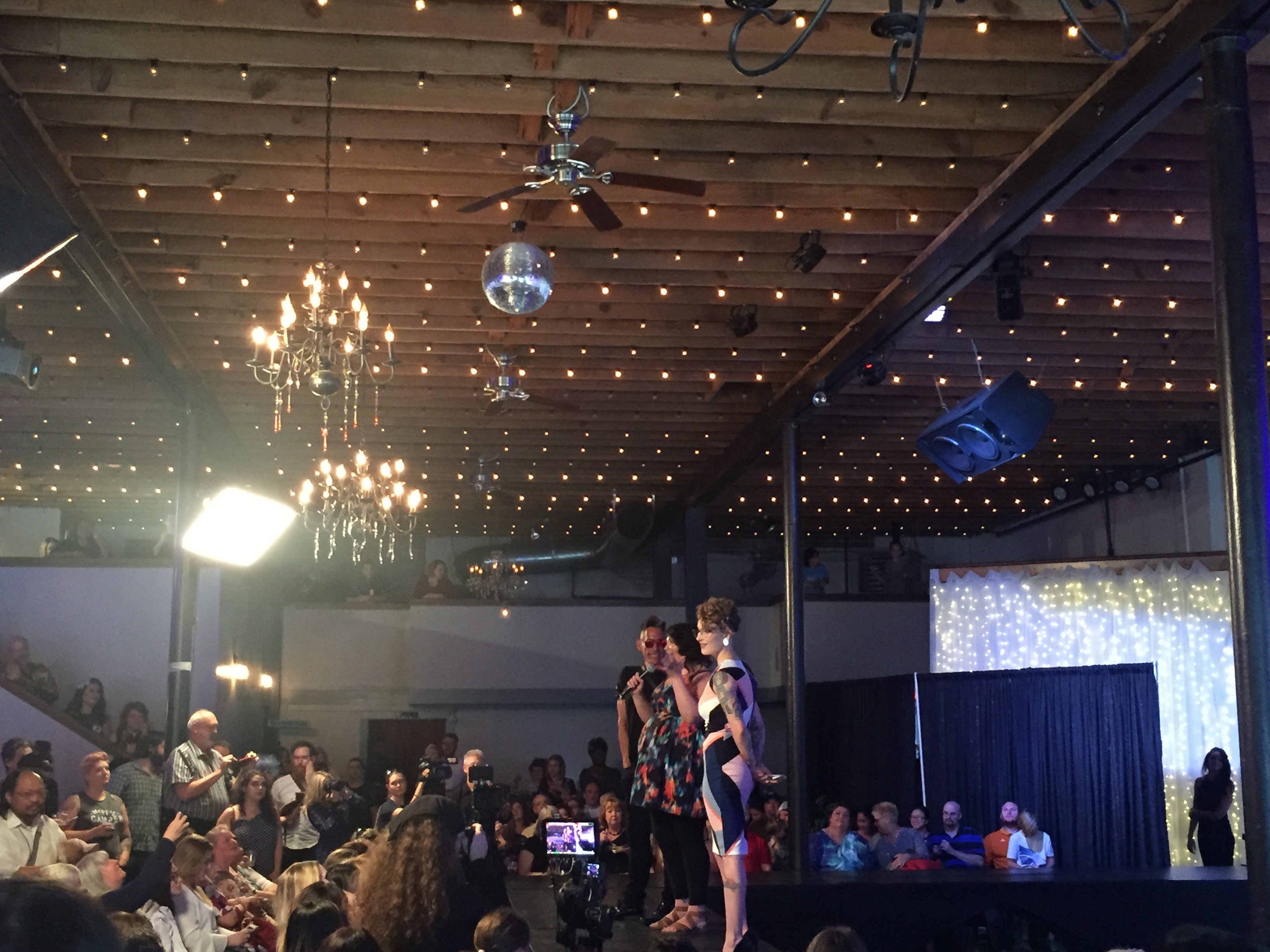 "aveda event ""knoxville on the catwalk"" with models posing on a runway"