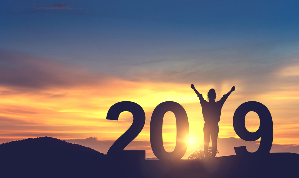 Woman celebrating the new year on a hill