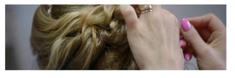 woman doing girl's hair
