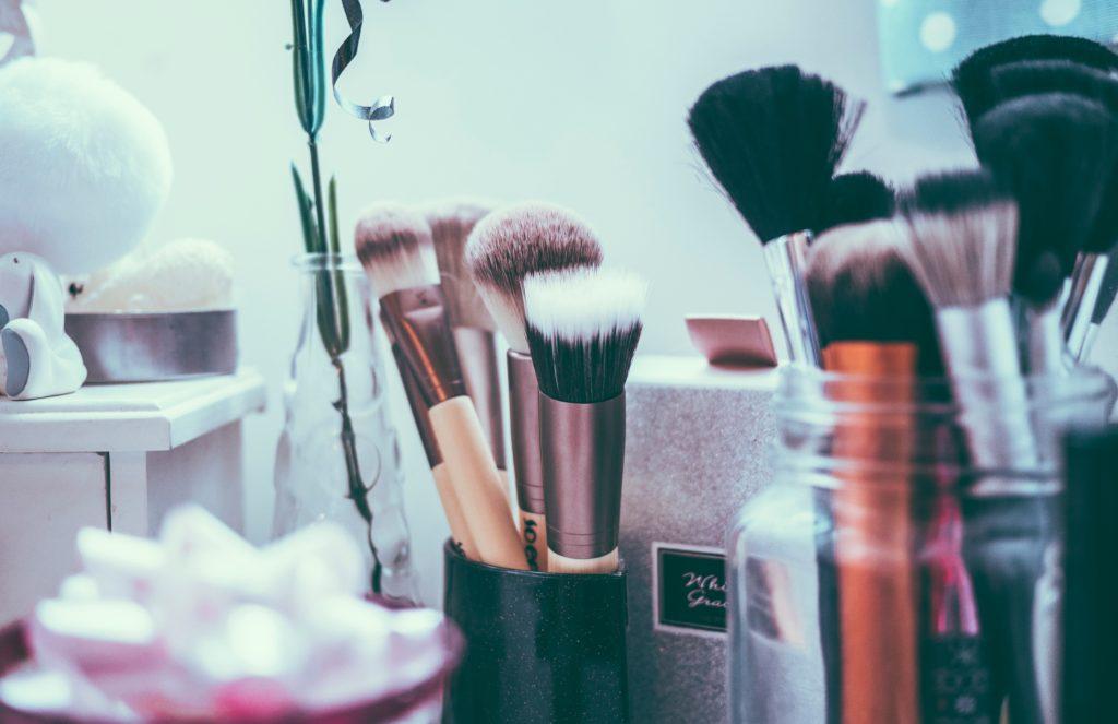 Makeup brushes in jars.
