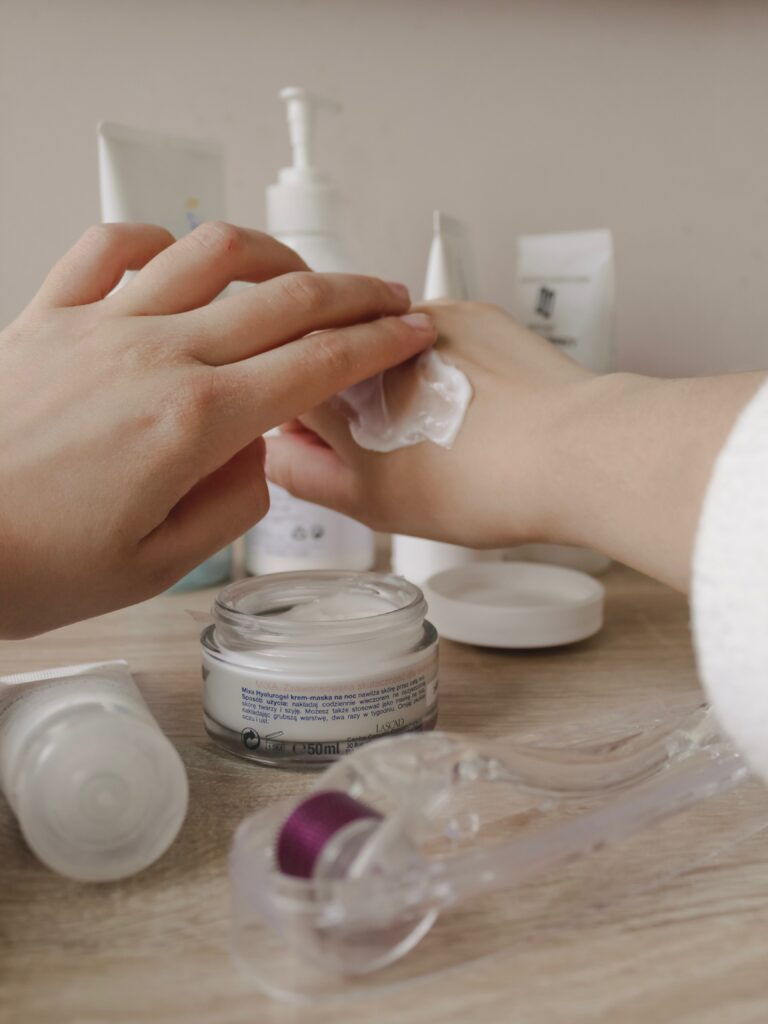 Woman using a thick moisturizer on her hands