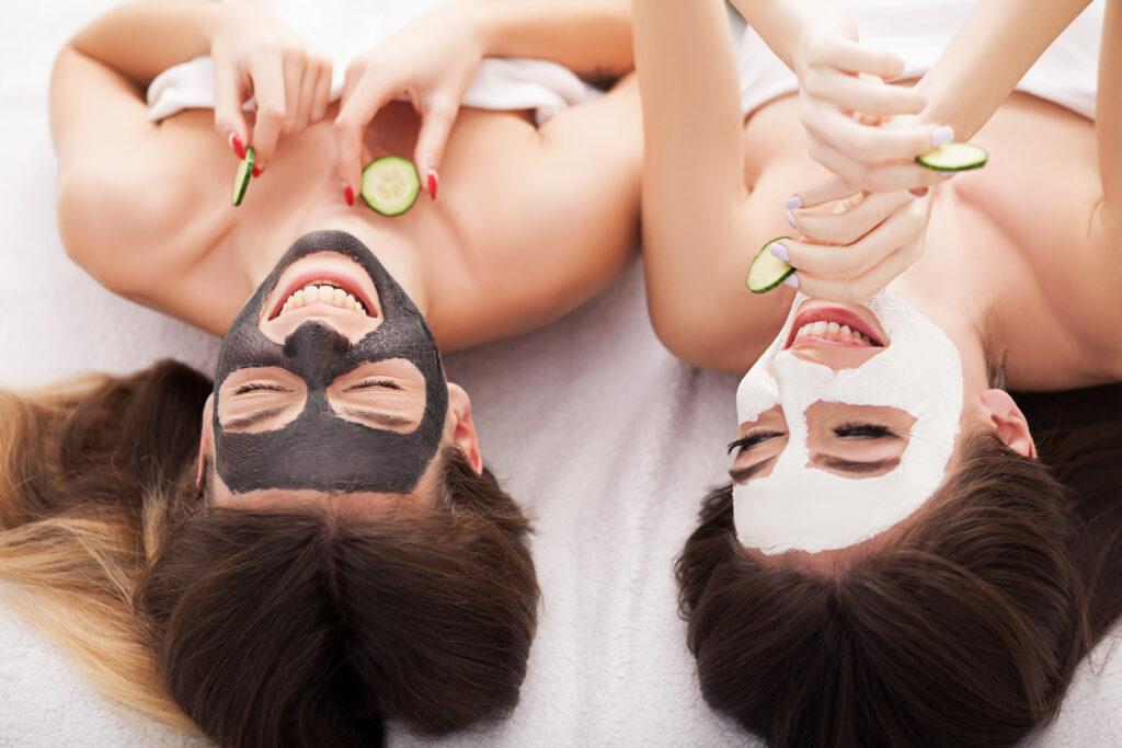 Girls laying down wearing face masks.