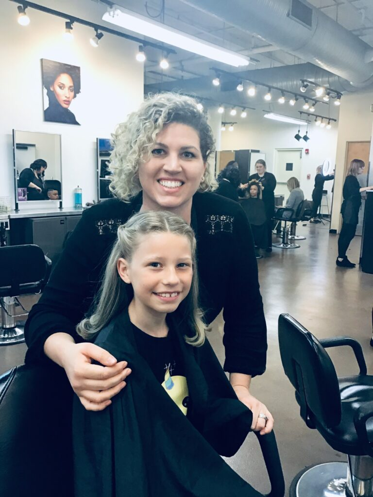 Mary Hall with a young client in a salon