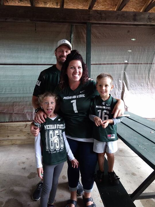 Mary Hall with her family wearing matching jerseys