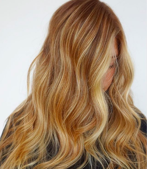Woman with beautiful golden blonde highlights.