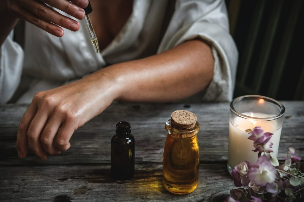 Woman using essential oils.