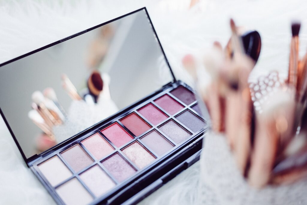 Pink-toned makeup palette and makeup brushes