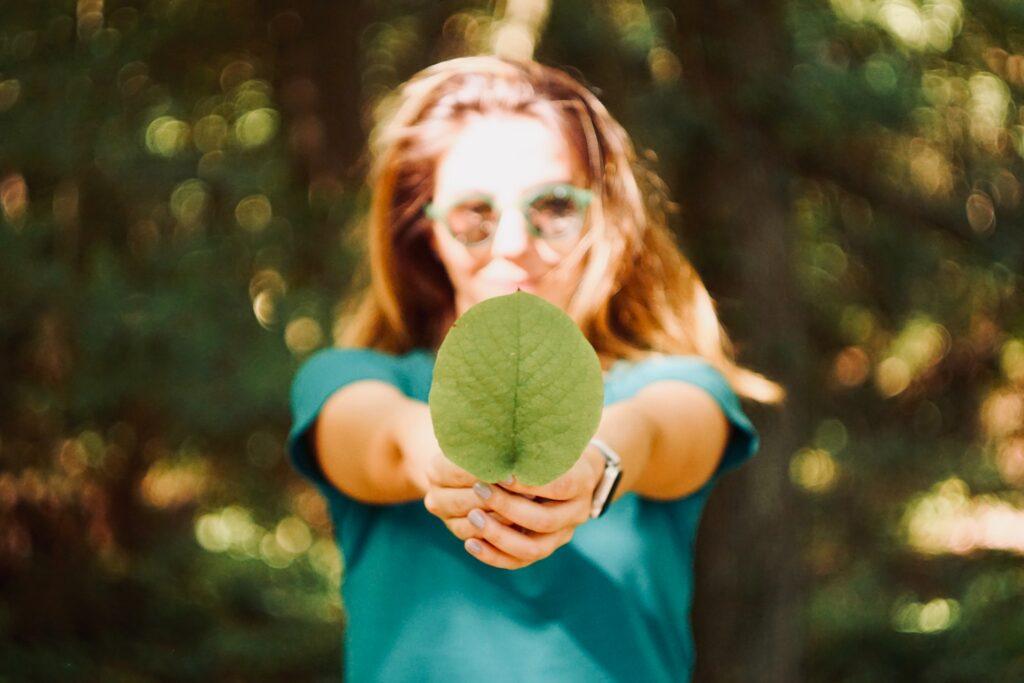 Girl holding a leaf.