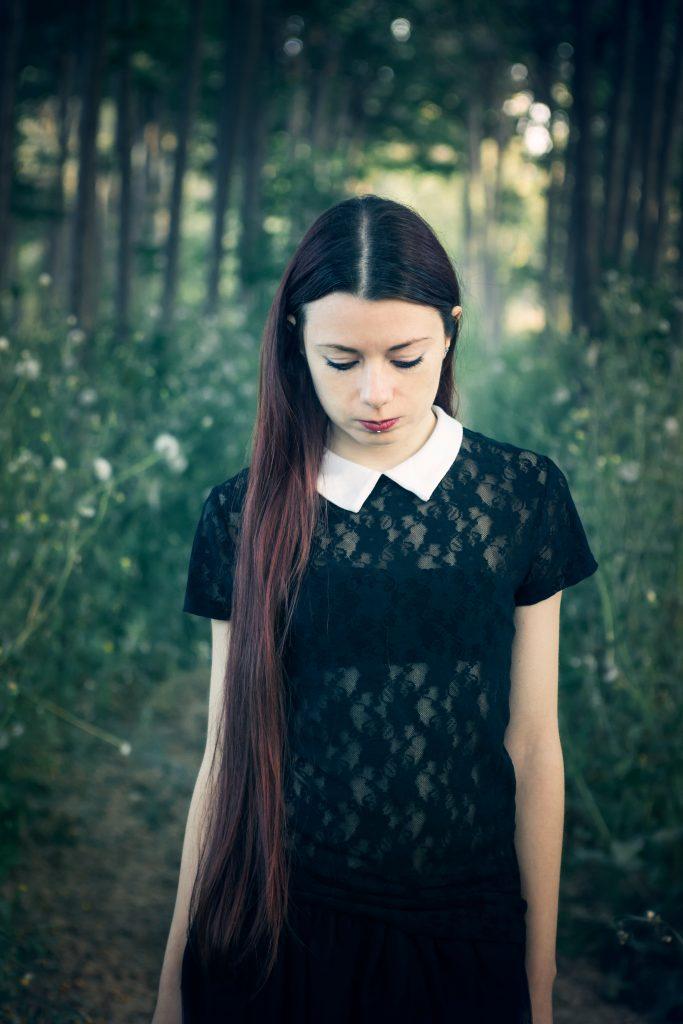 Girl dressed as Wednesday Addams