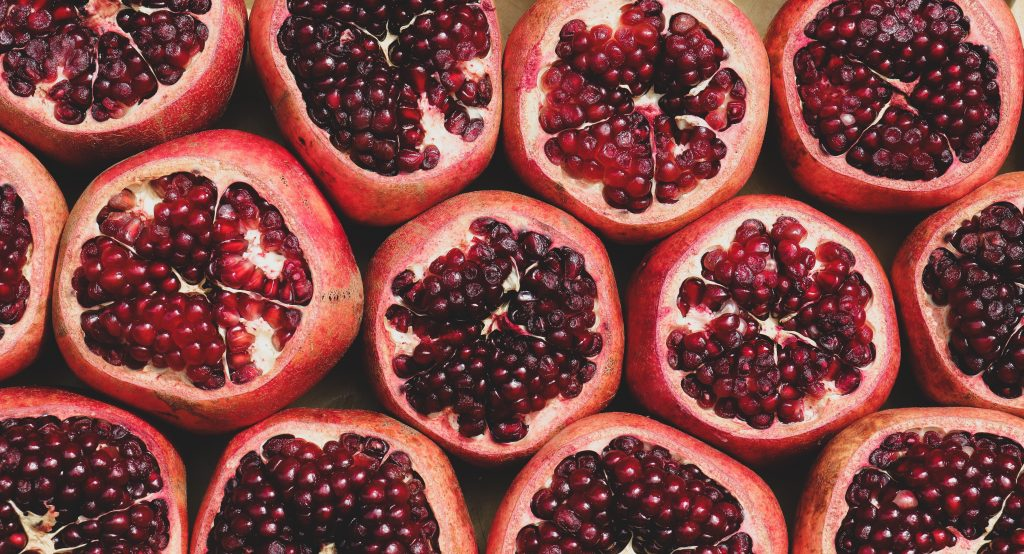 pomegranates cut in half